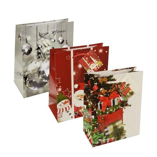 Buntbedruckte Lacktragetaschen in silber, rot und grün mit unterschiedlichen Weihnachtsmotiven