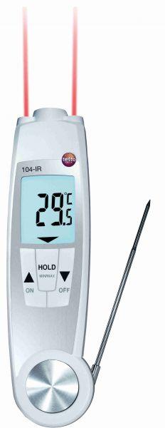 Infrarotthermometer mit aufgeklapptem Einstechfühler und leuchtenden Infrarotstrahlen